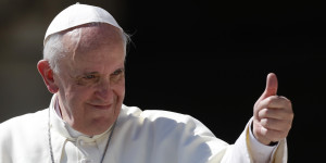 Pope Francis gives his thumb up as he leaves at the end of his weekly general audience in St. Peter's square